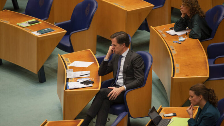 Dutch caretaker Prime Minister Mark Rutte has narrowly survived a vote of no confidence over his conduct during talks to form a governing coalition